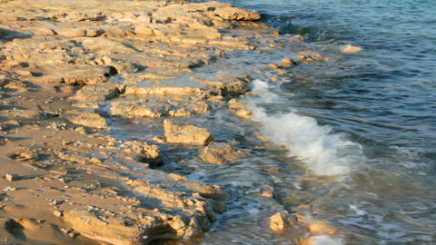 turquoise sea water waves and stones Footage