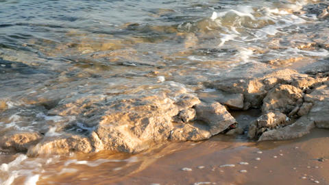 turquoise sea water waves and stones Stock Video Footage