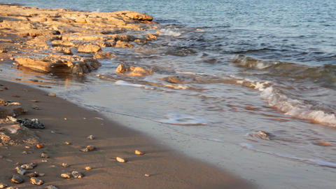 sea water waves and sand beach with stones Stock Video Footage