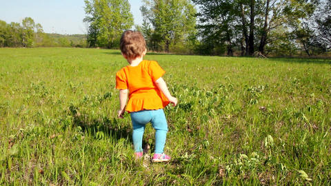Baby first steps on green lawn Footage