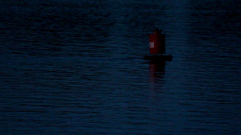 flashing buoy on the river at dusk Stock Video Footage