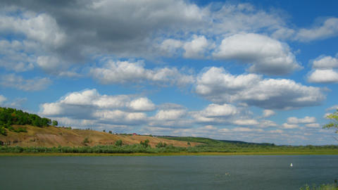 timelapse with clouds moving over river Stock Video Footage