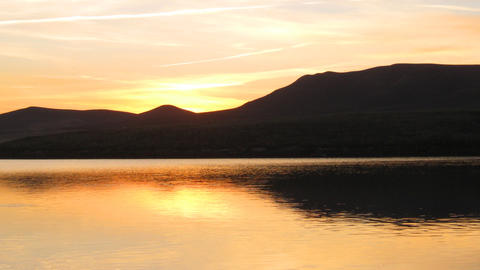 sunrise on morning lake with mountain Stock Video Footage