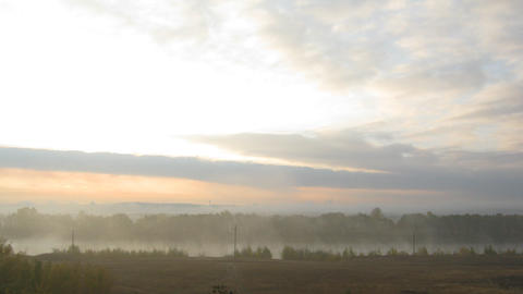 rural mist landscape with sunrise over lake Footage