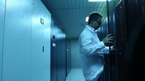 Man working in server room Stock Video Footage
