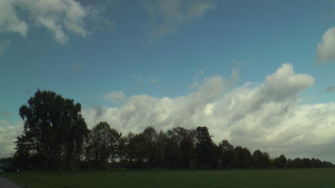 timel apse of moving clouds in green landscape Stock Video Footage