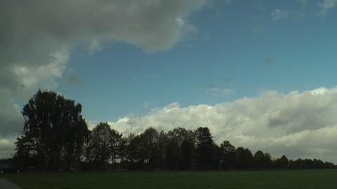 timel apse of moving clouds in green landscape Footage