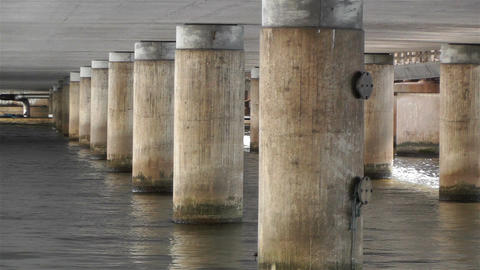Concrete Bridge Pillars in Water 2 Stock Video Footage