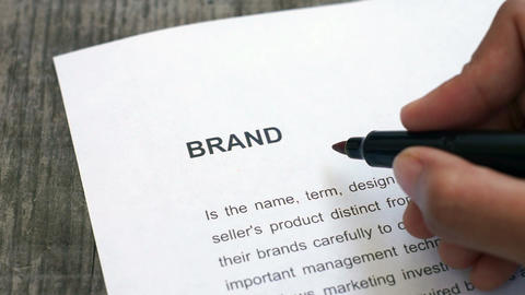 Circling brand with a red marker Stock Video Footage