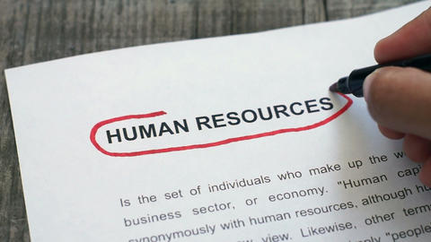Circling Human Resources with a red marker Stock Video Footage