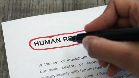 Circling Human Resources with a red marker Live Action