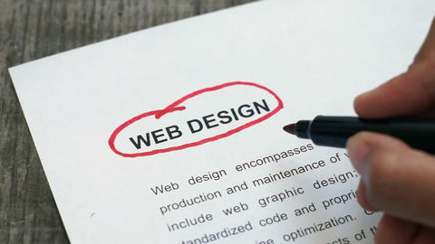 Circling Web Design With A Red Marker stock footage