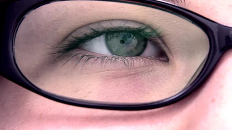 Extreme close up of an reading eye through the gla Stock Video Footage