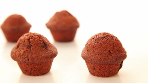 Chocolate cupcake, muffin on white background Stock Video Footage