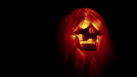 Spooky skull flying, scary evil head on black Stock Video Footage
