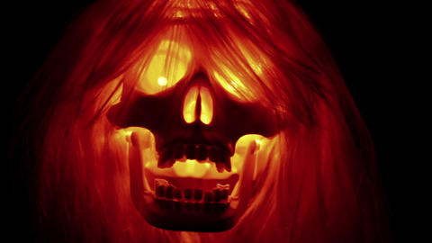 Halloween skull with hair on black background Stock Video Footage