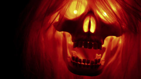Spooky skull flying, scary halloween background Stock Video Footage