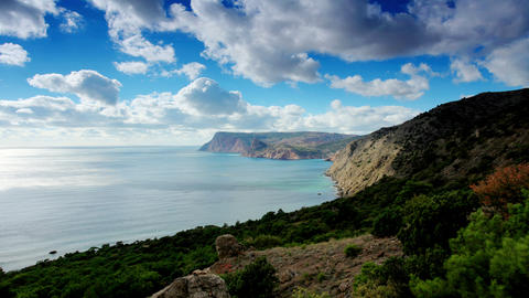 4K. Cloudy sky over the mountains and the sea. Bal Stock Video Footage