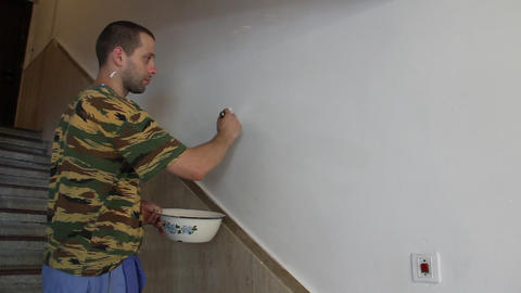 man painting with white paint Footage