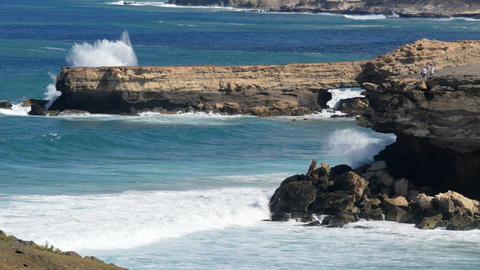 people watch big waves on rough beach 11138 Footage