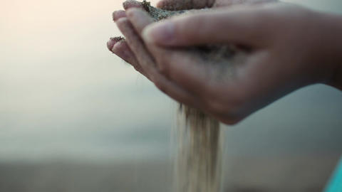 Sea sand running through a womans hands Stock Video Footage