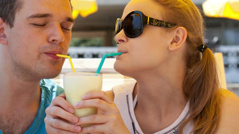 Romantic couple sharing a cocktail Stock Video Footage