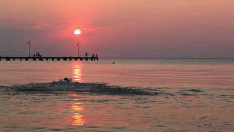 Man Swimming In The Sea At Sunset stock footage