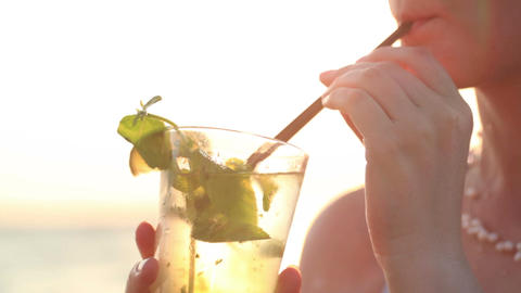 Woman enjoying a mojito cocktail Footage