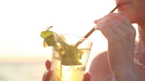 Woman enjoying a mojito cocktail Stock Video Footage