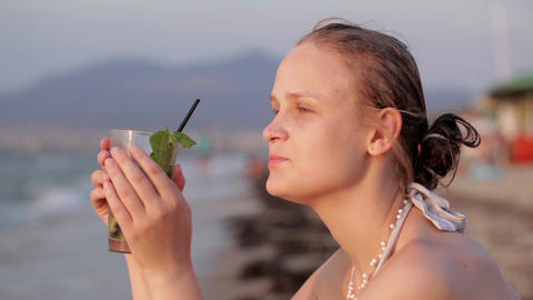 Woman enjoying an evening cocktail Footage