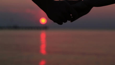Couple holding hands at sunset Stock Video Footage
