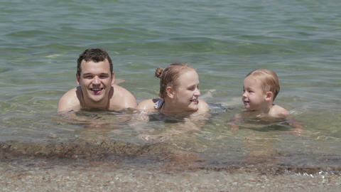 Young family in the sea Stock Video Footage