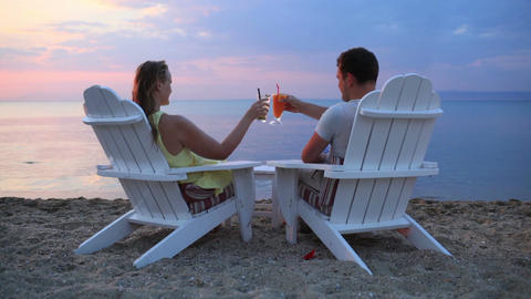 Romantic couple toasting the sunset Stock Video Footage