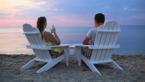 Romantic couple toasting the sunset Footage