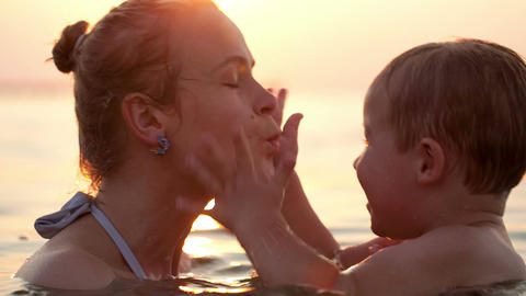 Mother kissing her young child Stock Video Footage