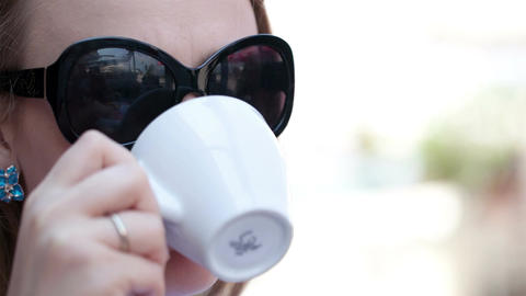 Young woman drinking coffee Stock Video Footage