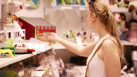 Shopping for toys in the supermarket Stock Video Footage
