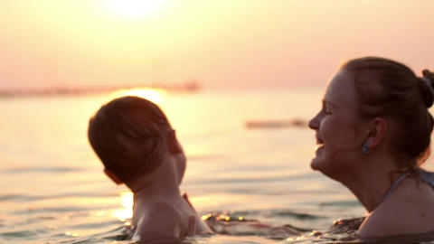 Mother and son swim in the sea Stock Video Footage