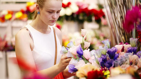 Beautiful young lady buying fresh flowers Footage