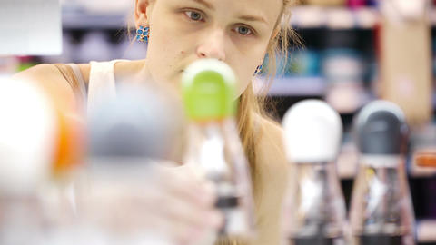Young woman analyzing products in a store Stock Video Footage
