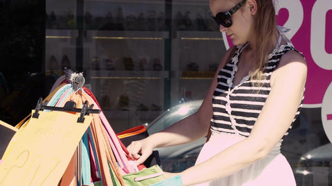 Woman shopping for bags Stock Video Footage