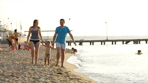 Young couple playing with their son at the seaside Stock Video Footage