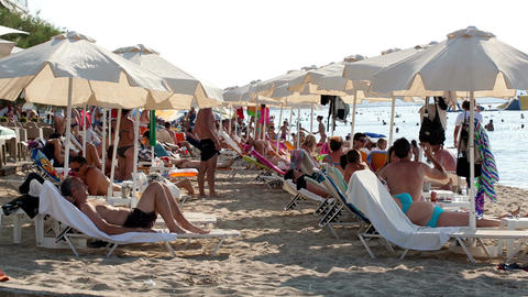 Crowded summer beach at a resort Stock Video Footage