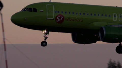 Landing of Passenger Plane at dawn Stock Video Footage