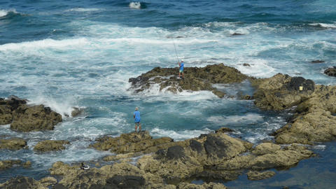 fishing on a rough coast 11148 Stock Video Footage