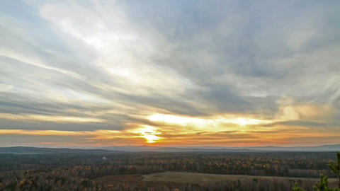 Sunset over the autumn forest. Time Lapse Stock Video Footage
