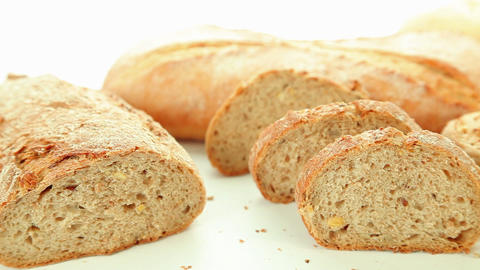 Fresh baked bread on white background Stock Video Footage