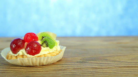 Sweet delicious cake with fruits on wood Stock Video Footage