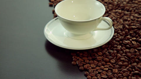 Empty white cup with coffee beans background Stock Video Footage