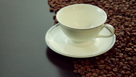 Empty white cup with coffee beans background Footage